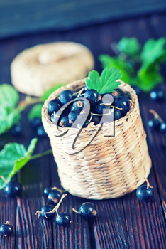 black currant in basket and on a table