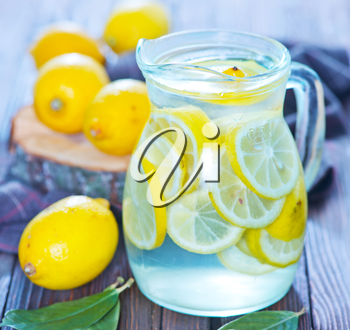 fresh lemonad in the jug and on a table