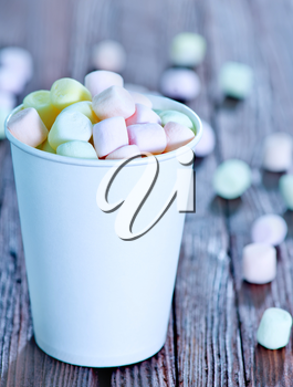 marshmallow in paper cup and on a table