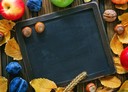 autumn harvest and chalkboard for note on a table