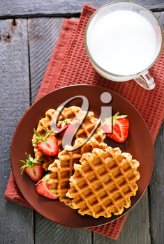 waffles on plate and on a table