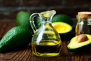 avocado oil in bottle and on a table
