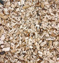 Heap of dirty woodchips with bark natural background