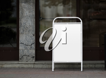 Street poster - clamshell in white painted steel frame. Clipping path. Shallow depth of field.