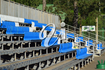 The seats in the stadium. Blue seats in the stands.