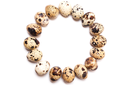 A round frame of quail eggs in a row on a white background. View from above, flat