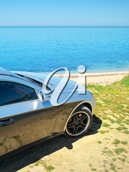 Car on the sea shore. Travel design.