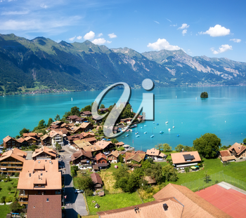 Aerial view on the town and Interlaken lake. Natural landscape from drone. Aerial landscape from air in the Switzerland