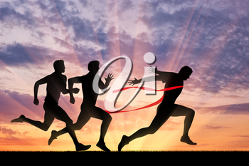 Running sports. Three runner and red tape that crosses a winner