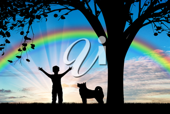 Happy child walking with dog near tree on background of rainbow. Friendship and happiness concept