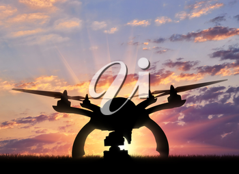 Silhouette drone taking off outdoors. Concept quadrocopters