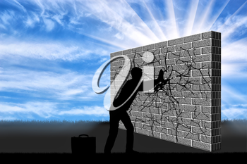 A silhouette of a businessman breaks the wall with your hands . The concept of overcoming challenges in business