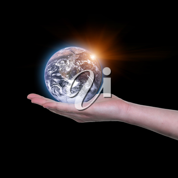 Earth in your hands, Saving Earth concept, Hands holding Earth with a black background. Elements of this image furnished by NASA