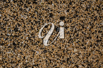 Macro view of the pebbles and stones on sandy beach in abstract background pattern
