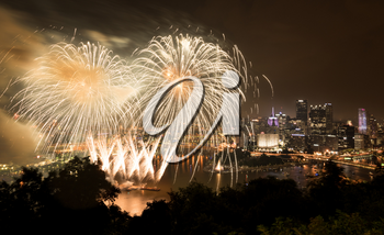 PITTSBURGH, PA - JULY 4, 2018: Fireworks from the river in front of downtown Pittsburgh on Independence Day.