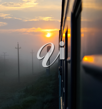 Passenger train rides against the sunset, Railway at sunset