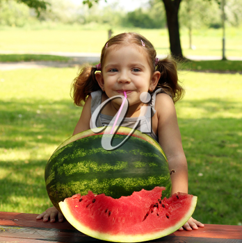 beauty little girl with watermelon summer scene