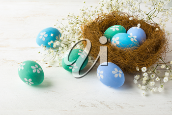 Easter eggs. Hand-painted Easter eggs in the nest. Pastel colored Easter eggs
