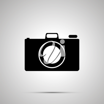 Photo camera silhouette, simple black icon with shadow