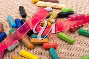 Used crayons of various color  wirh a ribbon