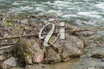 Rocks line the shore on the Snoqualmie River in Washington State.